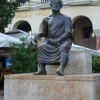A Statue Of Aristotle Within The Square