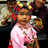 A Toddler Wearing Traditional Head Dress