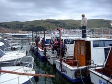 Boats In Puno City Harbour In Peru