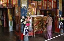 Devotee Praying At Drepung Monastery