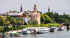 Guadalquivir River - Cruise Boats & Torre Del Oro In Seville - Spain Andalusia