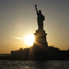 Sunset At Statue Of Liberty