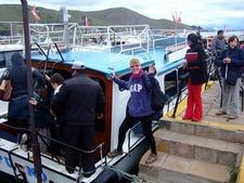 Tourists Boarding Cruise Boat In Puno City Peru
