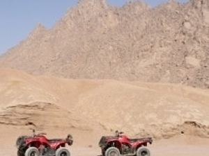 Sunset desert safari trip by quad runner Photos
