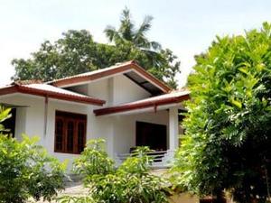 Happy caring hosts Sigiriya
