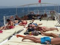 Sunbathing On The Boat